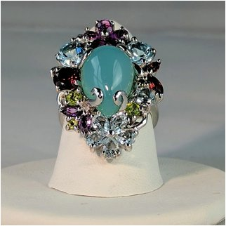 Product thumbnail: Chalcedony Surrounded by Multi Color Gems