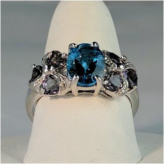Product thumbnail: Blue Topaz Surrounded by Six Amethyst