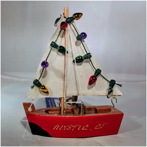 Red Sailboat with Multi Colored Lights