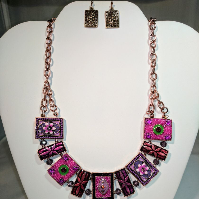 Pink/Purple Metals and Crystals - Earrings sold separately.