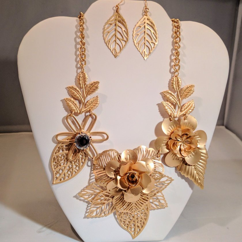 Gold Flower Necklace With Leaves - Earrings sold separately.