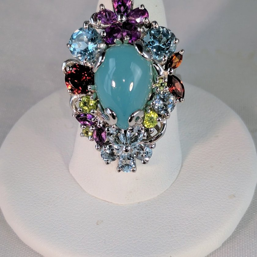 Chalcedony Surrounded by Multi Color Gems